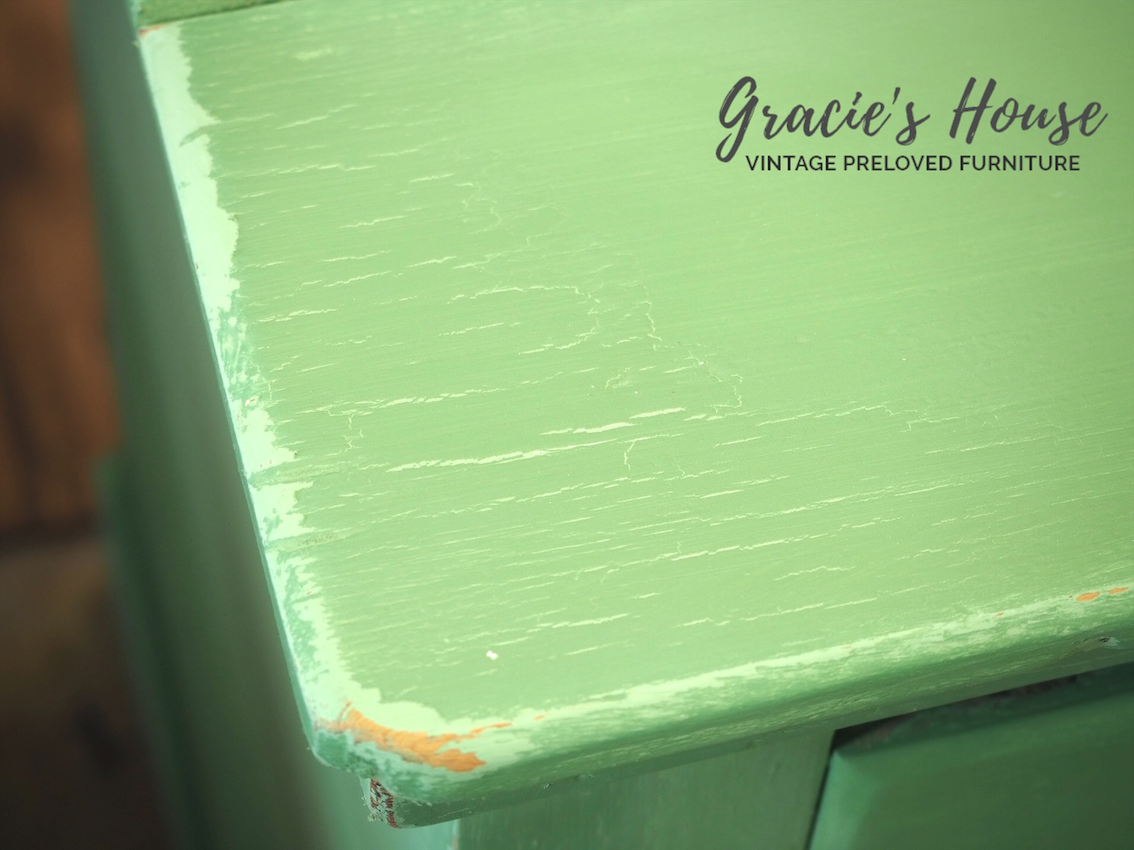 vintage green painted chest of drawers - close up - crackle